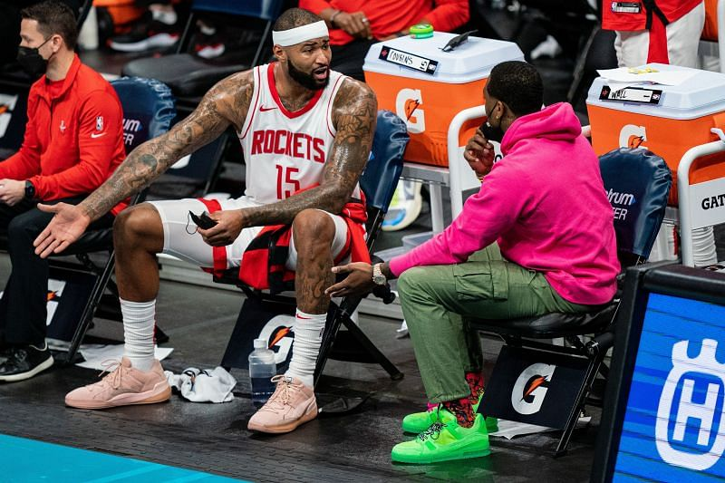 DeMarcus Cousins #15 of the Houston Rockets talks with John Wall, on the bench tonight due to injury, during the third quarter against the Charlotte Hornets at Spectrum Center on February 08, 2021 in Charlotte, North Carolina. (Photo by Jacob Kupferman/Getty Images)