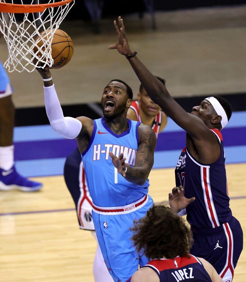 Houston Rockets John Wall #1 drives to the net against Isaac Bonga #17