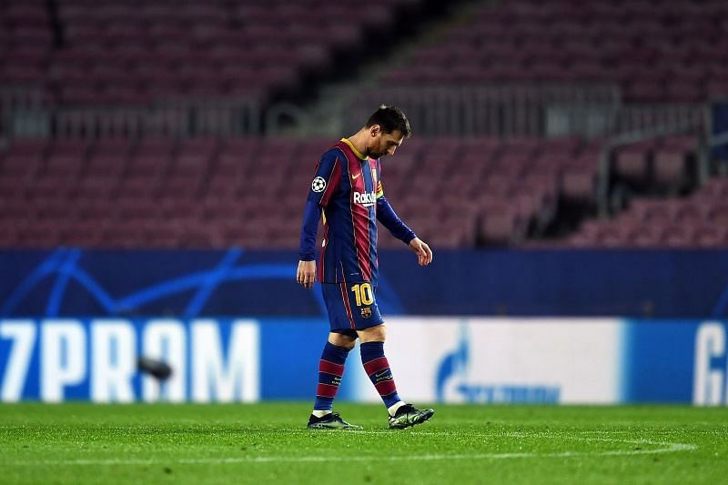 Lionel Messi looks dejected after losing to Paris Saint-Germain in the first leg of their Round of 16 tie