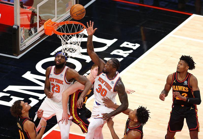 Julius Randle of the New York Knicks tips in the basket against the Atlanta Hawks