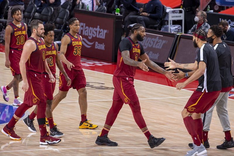 Andre Drummond of the Cleveland Cavaliers celebrates with teammates.