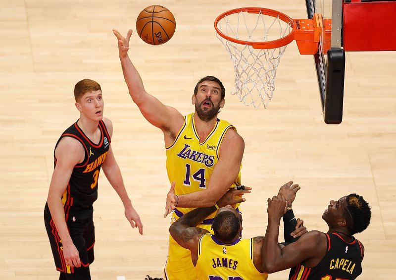 Marc Gasol #14 of the LA Lakers attacks the basket against Kevin Huerter #3 and Clint Capela #15 of the Atlanta Hawks