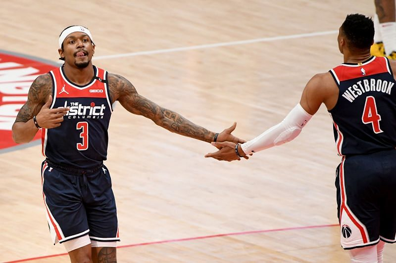 Bradley Beal #3 of the Washington Wizards celebrates with Russell Westbrook #4.