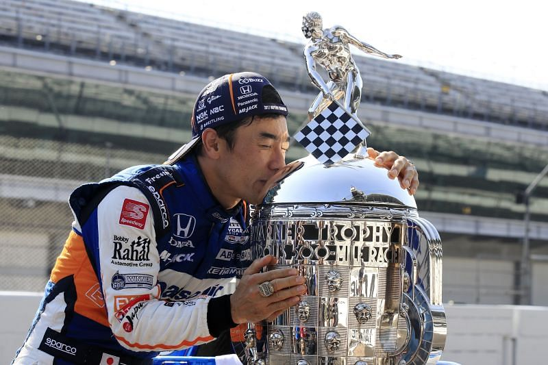 Takuma Sato kisses the Borg-Warner Trophy after winning the Indianapolis 500 for the second time. (Photo by Andy Lyons/Getty Images)