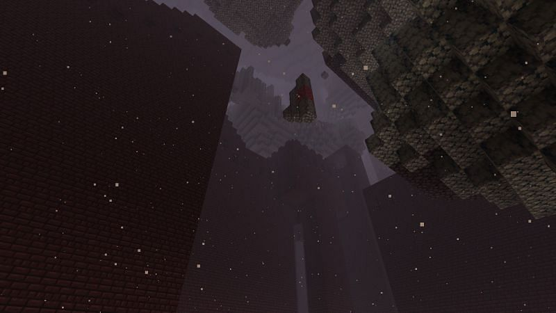 A menacing shot of a Nether Fortress in Minecraft (Image via Minecraft)