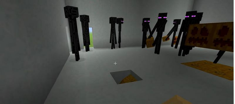 Endermen mobs creating a Snow Golem in Minecraft (Image via ibxtoycat/YouTube)