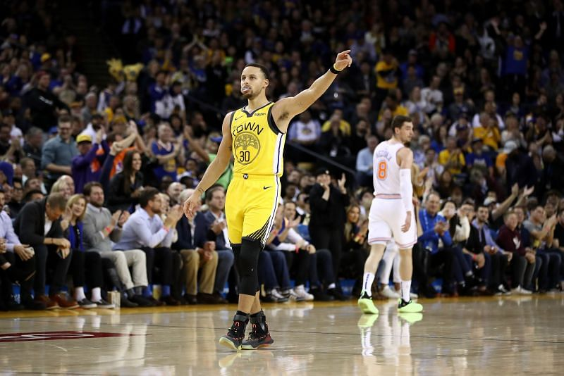 Stephen Curry of the Golden State Warriors reacts after a made basket against the New York Knicks