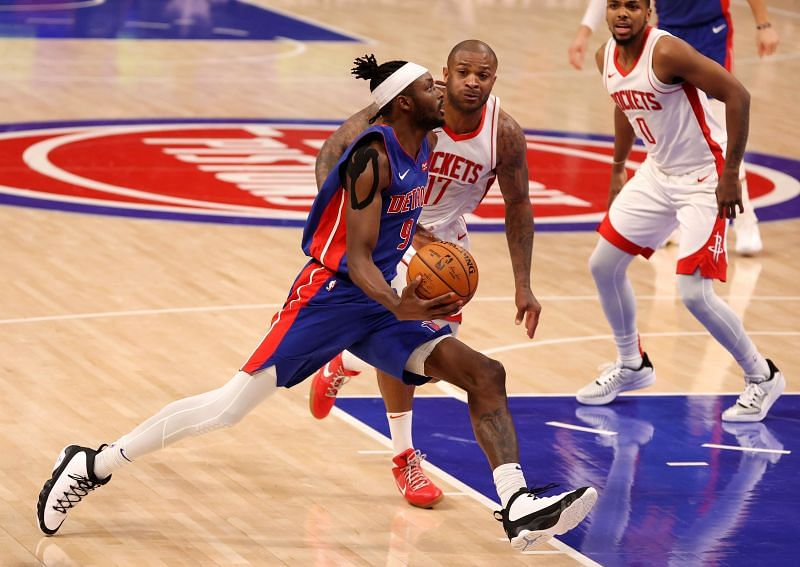Jerami Grant (#9) of the Detroit Pistons drives to the basket past PJ Tucker (#17) of the Houston Rockets.