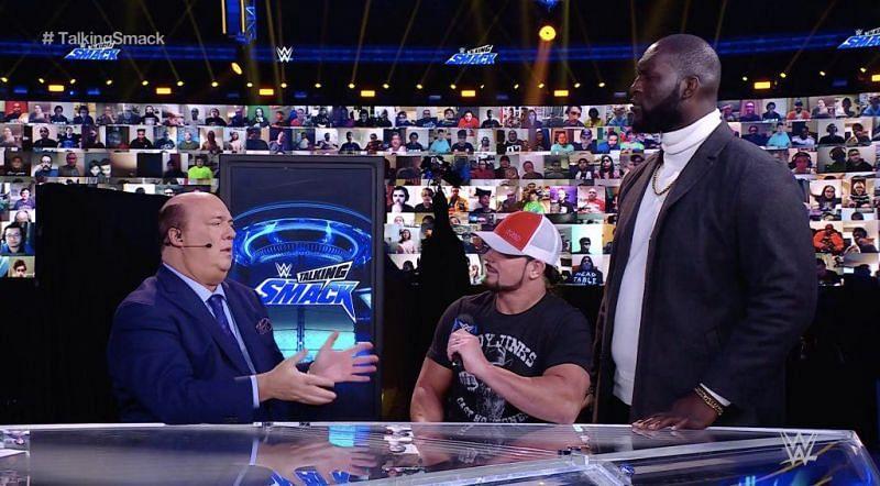 Paul Heyman, AJ Styles, and Omos