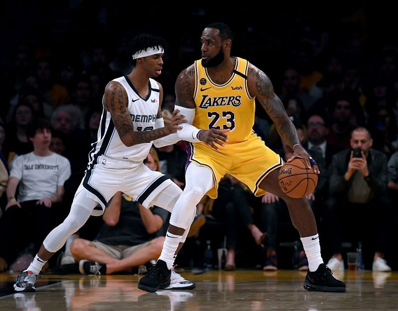 LeBron James #23 of the Los Angeles Lakers posts up Ja Morant #12 of the Memphis Grizzlies