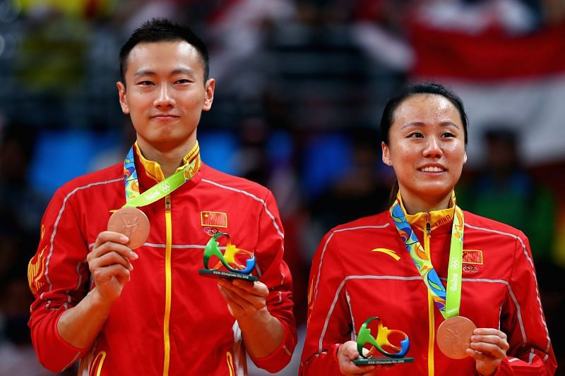 Bronze medalists, Nan Zhang and Yunlei Zhao of China celebrate after the Mixed Doubles Gold Medal Match at the Rio 2016 Olympic Games