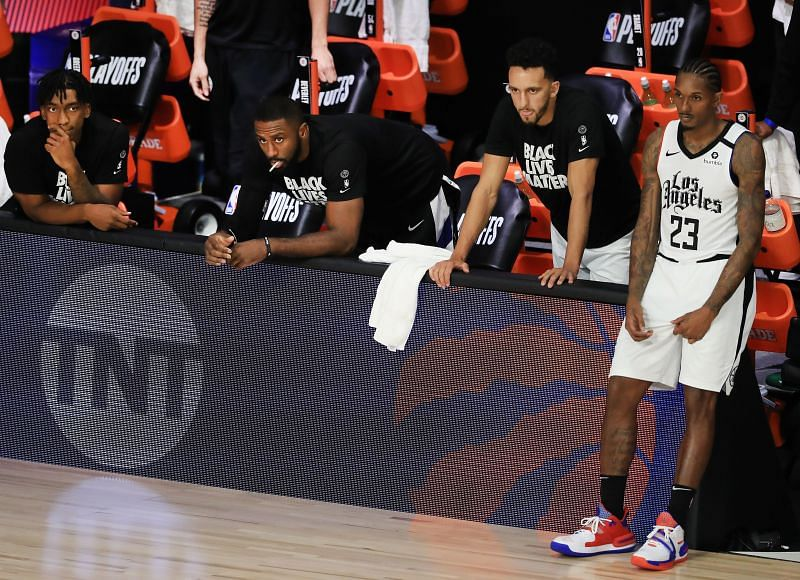 Lou Williams #23 of the LA Clippers and the LA Clippers bench react during the fourth quarter against the Denver Nuggets in Game Five of the Western Conference Second Round during the 2020 NBA Playoffs