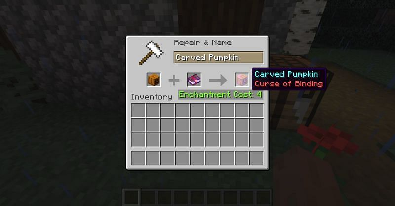 Placing Curse of Binding on a carved pumpkin with an enchanted book and anvil in Minecraft. (Image via Minecraft)