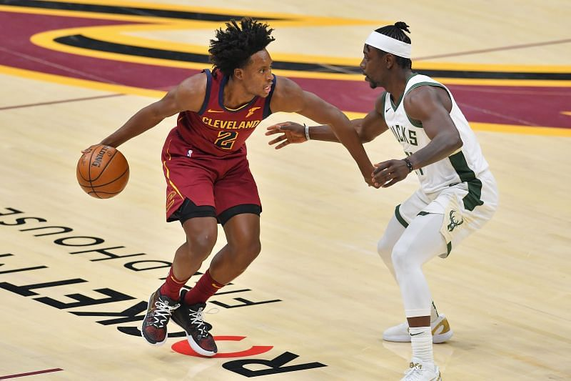 Collin Sexton of the Cleveland Cavaliers drives past Jrue Holiday of the Milwaukee Bucks during the third quarter at Rocket Mortgage Fieldhouse. (Photo by Jason Miller/Getty Images)