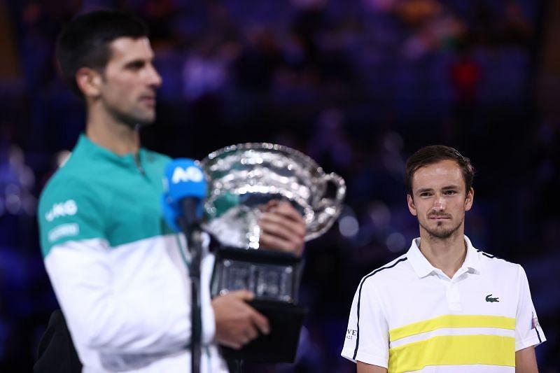 Daniil Medvedev looks on as Novak Djokovic gives his winner