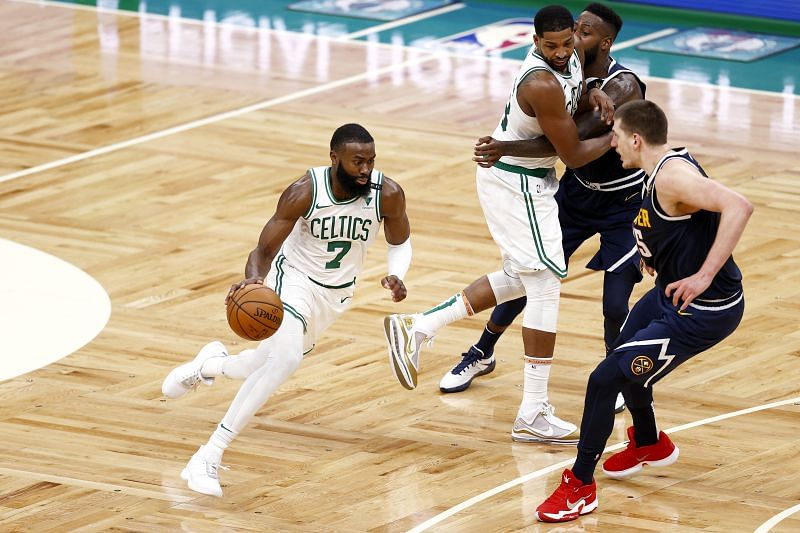 Jaylen Brown (#7) of the Boston Celtics drives towards the basket.