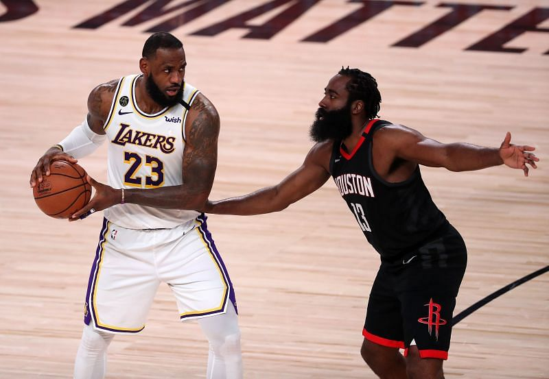 LeBron James of the Los Angeles Lakers drives the ball against James Harden of the Houston Rockets in the Western Conference Second Round during the 2020 NBA Playoffs (Photo by Michael Reaves/Getty Images)