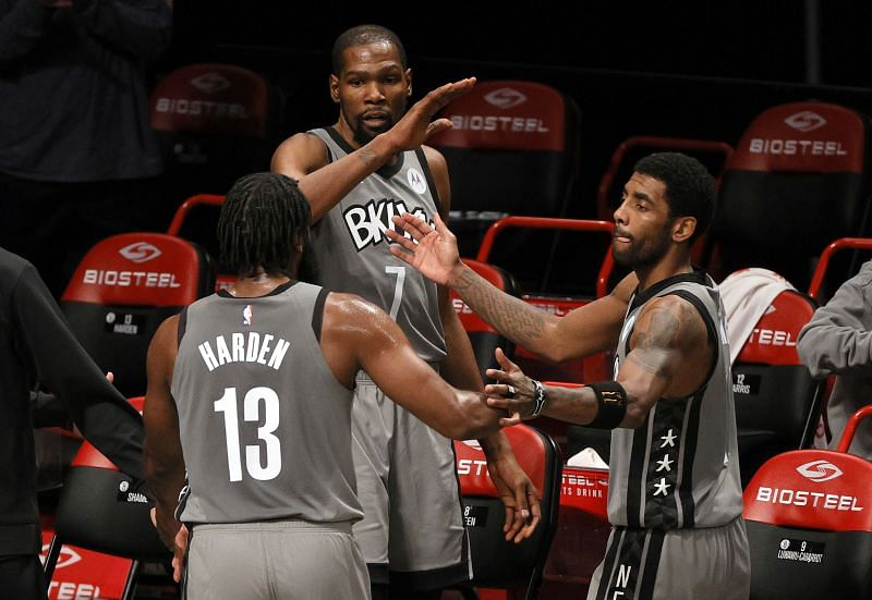 James Harden (#13), Kevin Durant (#7) and Kyrie Irving (#11) of the Brooklyn Nets