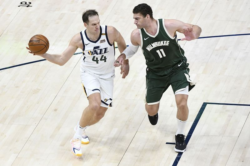 Bojan Bogdanovic #44 of the Utah Jazz passes around Brook Lopez #11 of the Milwaukee Bucks.