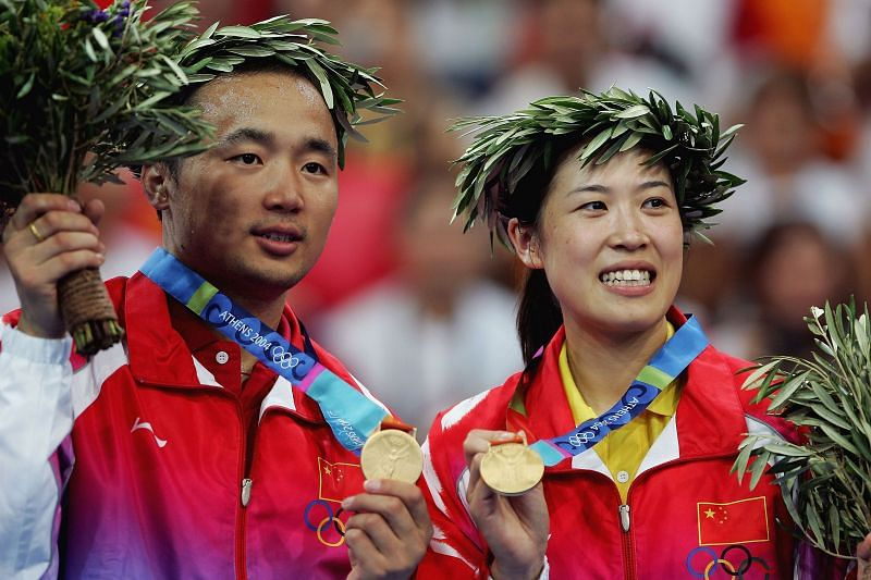 Jun Zhang and Ling Gao of China win the gold medal in the mixed doubles badminton event during the Athens 2004 Summer Olympic Games