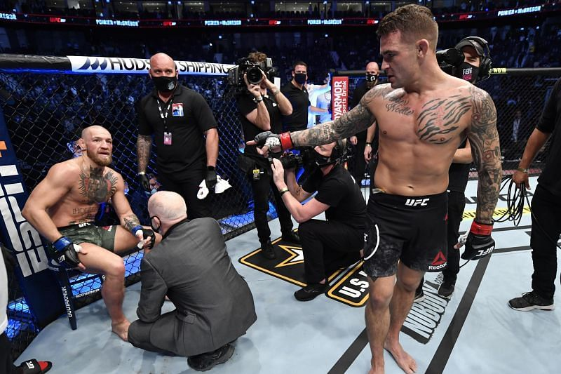 Conor McGregor (on the stool) sustained damage to his peroneal nerve during his fight against Dustin Poirier (standing) at UFC 257