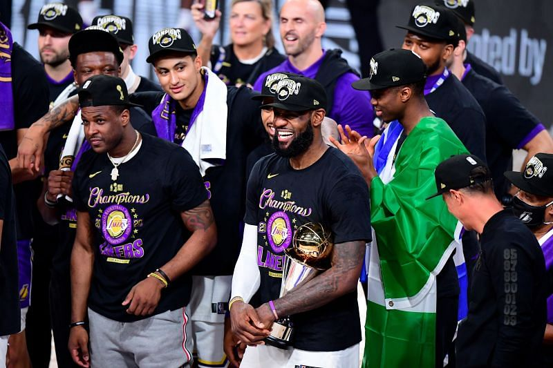 LeBron James #23 of the LA Lakers reacts with his MVP trophy after winning the 2020 NBA Championship over the Miami Heat in Game Six of the 2020 NBA Finals