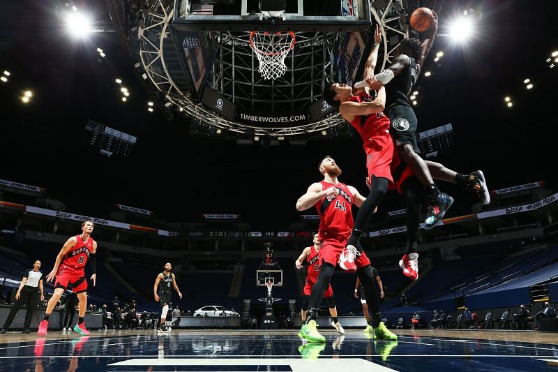 Minnesota Timberwolves forward Anthony Edwards dunks on the Toronto Raptors