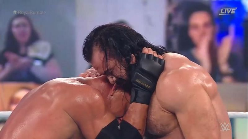 Goldberg and Drew McIntyre share an embrace