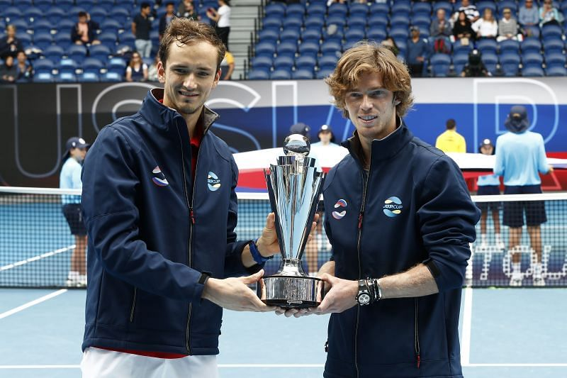 Daniil Medvedev and Andrey Rublev with the ATP Cup trophy