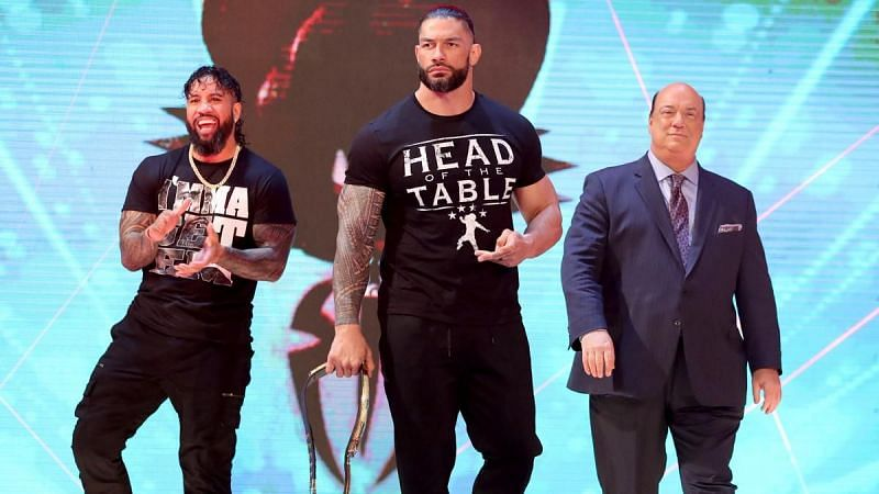 Jey Uso, Roman Reigns, and Paul Heyman
