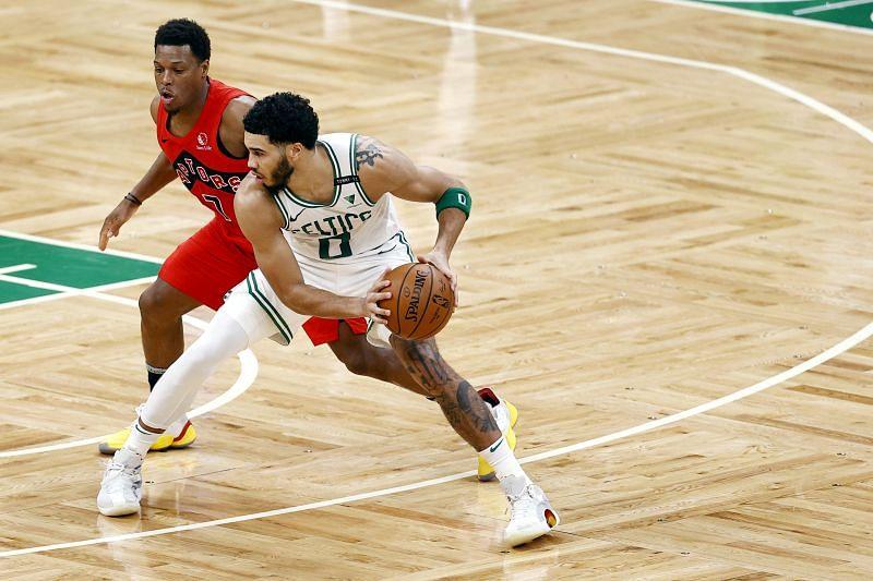 Kyle Lowry #7 of the Toronto Raptors defends Jayson Tatum #0 of the Boston Celtics