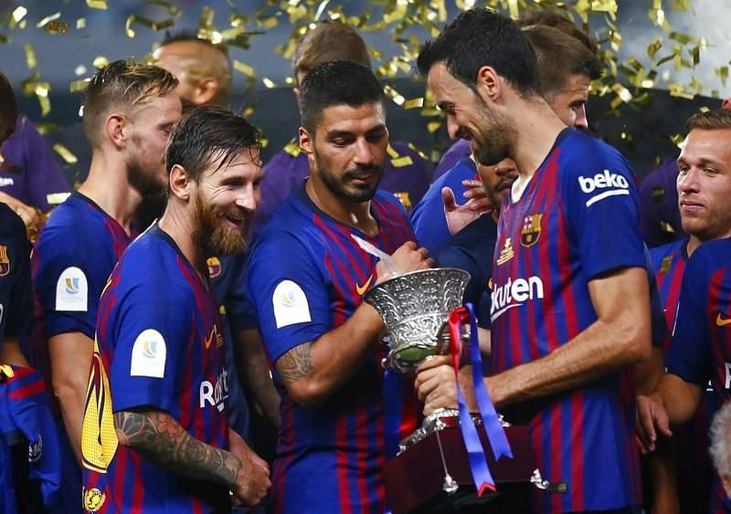 Lionel Messi (second from left) has won the most titles by any Barcelona player.