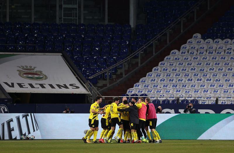 Borussia Dortmund players celebrate beating Schalke