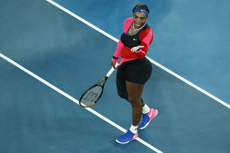 Serena Williams celebrates after beating Simona Halep