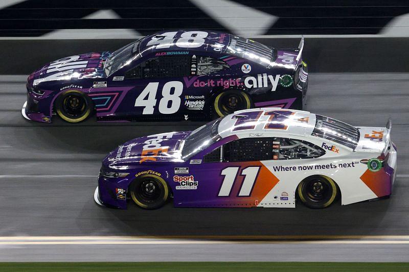 Alex Bowman (48) races Denny Hamlin in Duel 1 at Daytona.