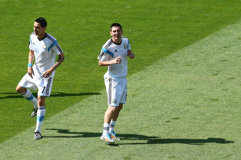 Angel Di Maria and Lionel Messi before an Argentina game