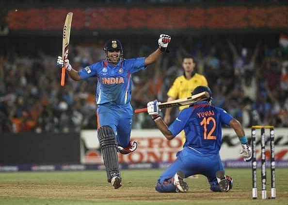 Suresh Raina and Yuvraj Singh celebrate after India