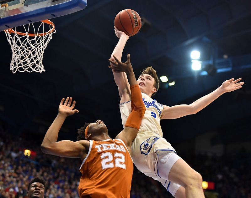 Christian Braun #2 of the Kansas Jayhawks is fouled by Kai Jones #22 of the Texas Longhorns