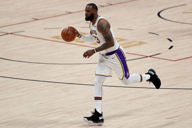 LeBron James of the LA Lakers brings the ball up against the Denver Nuggets