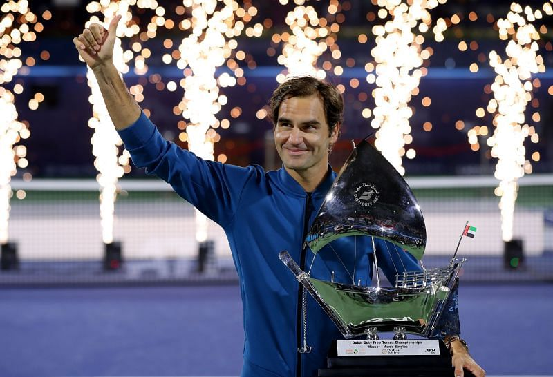 Roger Federer with the trophy at the Dubai Duty Free Championships in March 2019