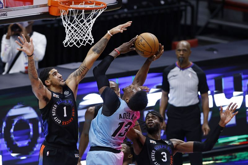 Bam Adebayo of the Miami Heat shoots over Nerlens Noel and Obi Toppin of the New York Knicks (Photo by Michael Reaves/Getty Images)