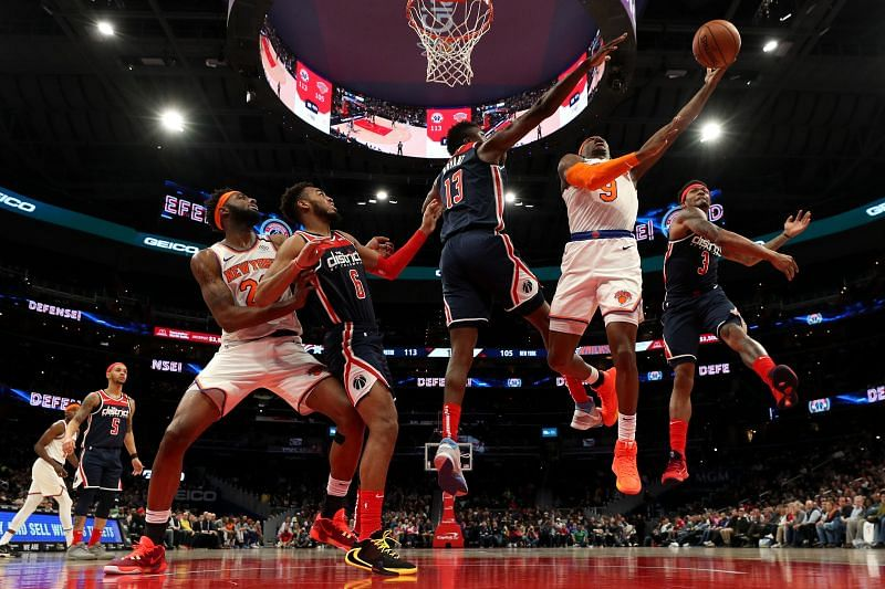 RJ Barrett #9 of the New York Knicks shoots in front of Thomas Bryant #13 and Bradley Beal #3 of the Washington Wizards
