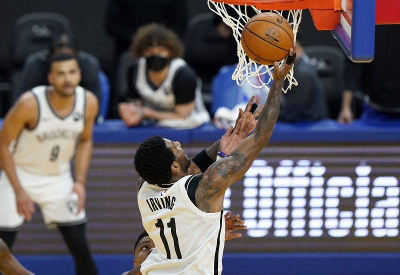 Kyrie Irving #11 of the Brooklyn Nets goes in for a layup against the Golden State Warriors during the first half of an NBA basketball game at Chase Center on February 13, 2021 (Photo by Thearon W. Henderson / Getty Images)