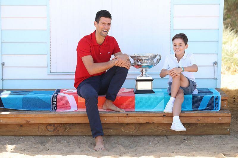 Novak Djokovic with a young tennis fan after winning the 2021 Australian Open