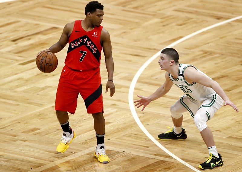 Payton Pritchard #11 of the Boston Celtics defends Kyle Lowry #7 of the Toronto Raptors during the second quarter at TD Garden on February 11, 2021 in Boston, Massachusetts.
