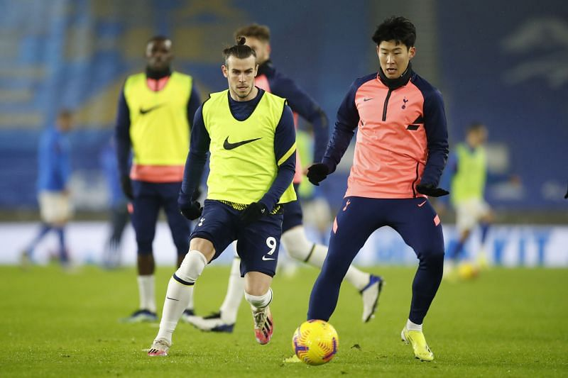 Gareth Bale and Son Heung-Min of Tottenham Hostpur warm up ahead of the game against Brighton