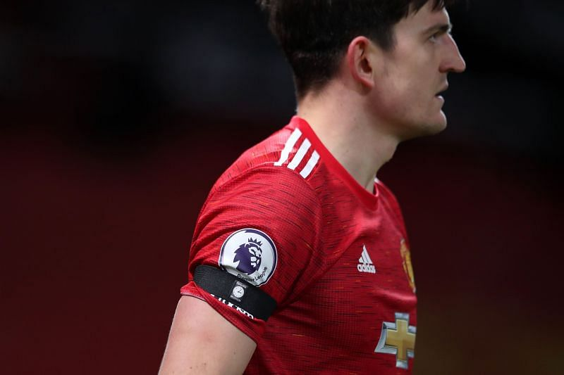 Harry Maguire with the captain