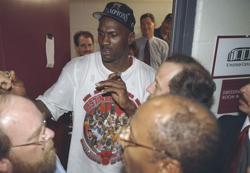 Michael Jordan of the Chicago Bulls is interviewed in the locker room after the Bulls win game 6 of the 1997 NBA Finals