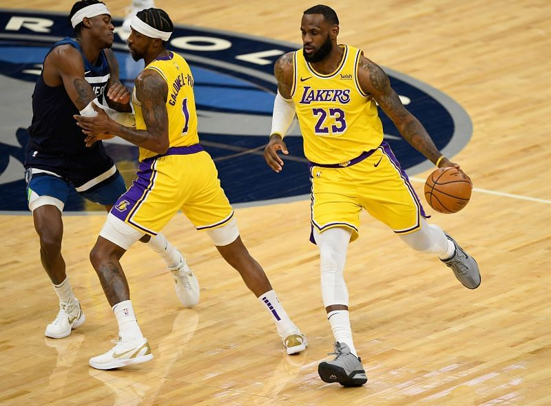 Kentavious Caldwell-Pope #1 of the Los Angeles Lakers sets a pick for Jarred Vanderbilt #8 of the Minnesota Timberwolves as teammate LeBron James #23 dribbles past during the first quarter of the game at Target Center on February 16, 2021 (Photo by Hannah Foslien/Getty Images)