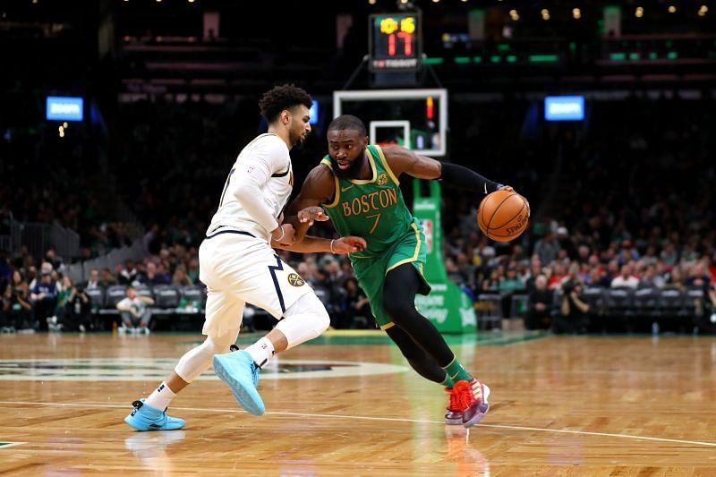 Jaylen Brown (#7) of the Boston Celtics drives against Jamal Murray (#27) of the Denver Nuggets.